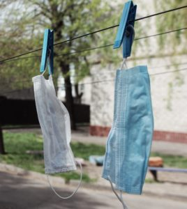 blue denim jeans hanged on clothes hanger